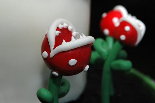 Mario eating plants on cake